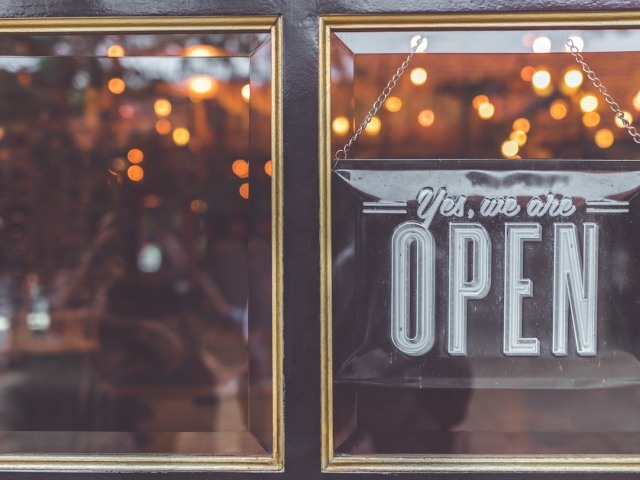 Open sign hanging in window