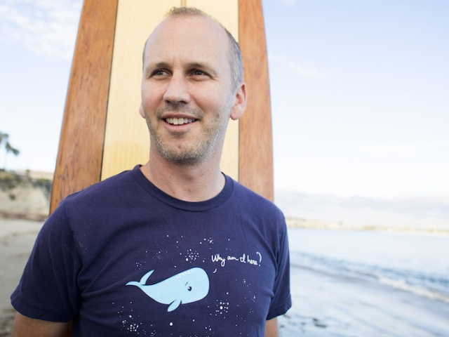 Ben Halpern standing with surf board on beach