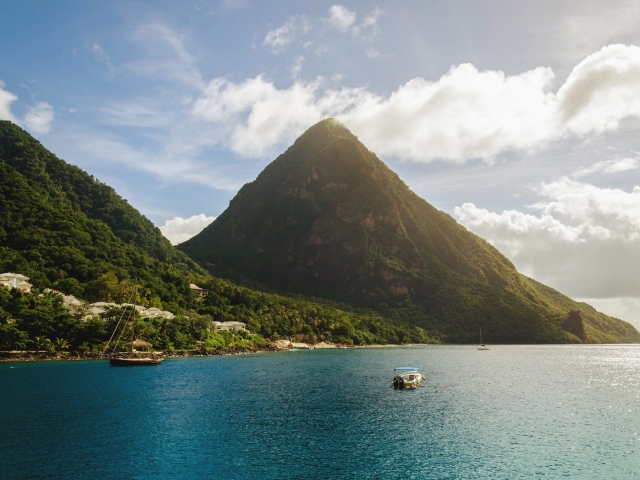 Island mountain with boats in the water