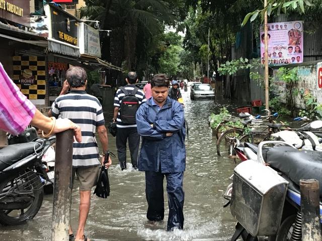 People walking in a flooded street