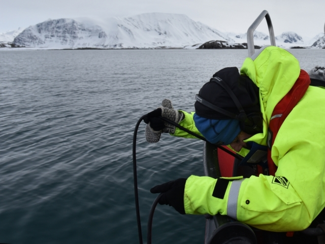 Researcher monitoring sound in the arctic