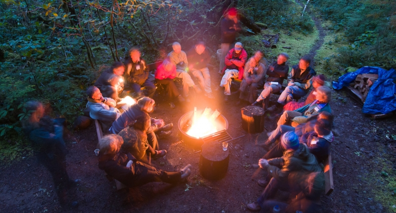 Group of about 15 people around campfire