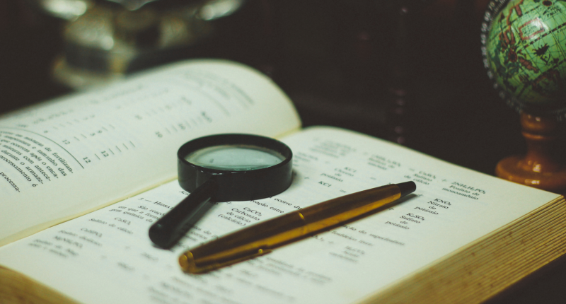 Magnifying glass lying on open book