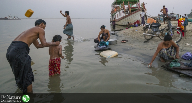 People bathing and washing in a river